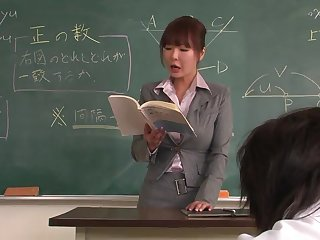 Lecturer helps a well-draped schoolgirl to concentrate on the specification