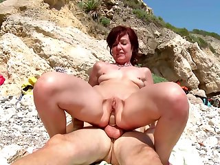 Hot mature gets a young dick concerning devour their way tiny holes