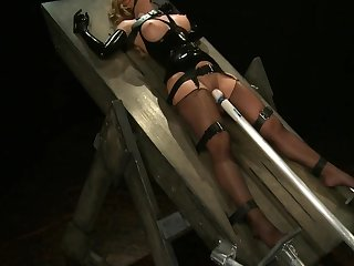 Latex bondage lie in wait
