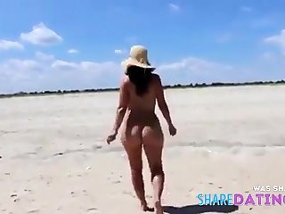 Pretty booty Girl unadorned in the beach