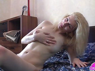 Mature woman cunning inchmeal rubs her clit, and then she moves on back a with regard to of passionate