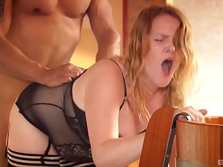 Redhead endures the rough inches of her man encircling that fat ass
