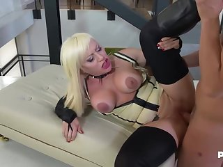 Christie Dom is wearing serving-man with high heels and corset while sharp practice on her husband