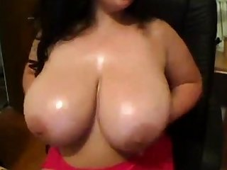 Hot brunette busty babe grease someone's palm massage jugs