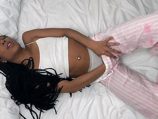 Ebony woman rubs pussy before going to sleep