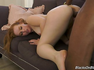 Doggy style with a black coxcomb leads the redhead to insane orgasms