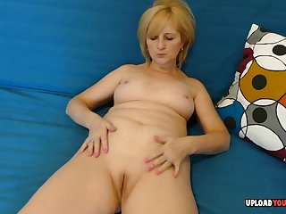 Sexy milf strips gone her apparel and pleasures herself during her solo session.
