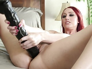 Redhead toy fucks her shaved in merciless solo